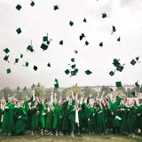 Students Tossing Hats at Graduation