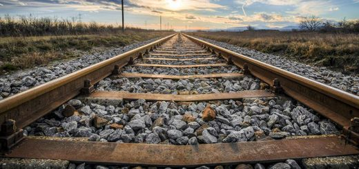 Railroad Tracks To Horizon